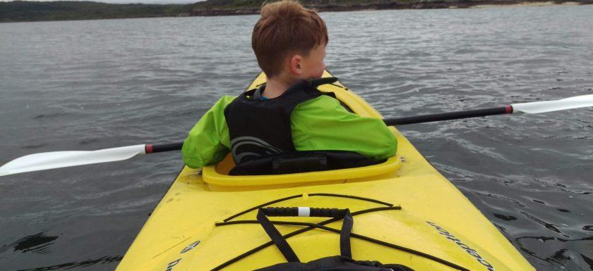 Reuben, aged 7, Sea Kayaking while staying at Reuben's Highland Retreat Self Catering Lodges